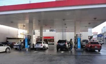 Los combustibles bajarán 5% a partir del 1 de enero